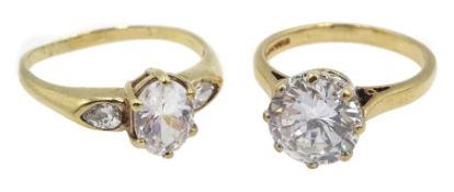 Gold single stone cubic zirconia ring and one other gold cubic zirconia dress ring, both hallmarked