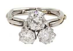 Early 20th century platinum three stone old cut diamond ring, on later 17ct white gold expanding sha