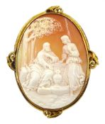 Victorian 13ct gold cameo brooch depicting figures in a garden setting