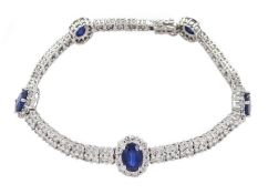 18ct white gold oval sapphire and round brilliant cut diamond link bracelet, hallmarked, total sapph
