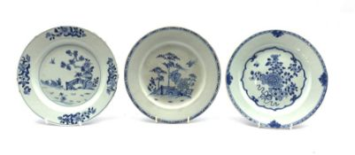 Three Chinese Export blue and white plates, two decorated with a fence garden and the other with chr