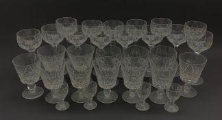 Part suite of Stuart crystal drinking glasses comprising fourteen hock glasses, twelve various shape