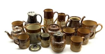 Collection of Doulton and other harvest ware including teapot with silver collar, mugs in various si