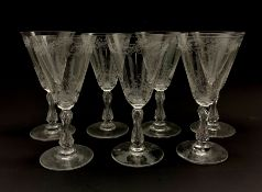 Set of seven early 20th century claret glasses decorated in the Baccarat style with foliate engraved