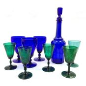 Three Georgian green wine glasses the bowls etched with fruiting vines, a matching wine glass, 19th