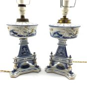 Pair of 19th century German blue and white porcelain 'oil' lamps, the reservoir relief moulded with