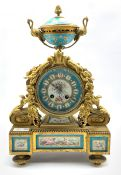 19th century French mantel clock, gilt metal with urn finial over case profusely decorated with a fl