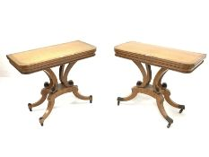 Pair of early 19th century crossbanded walnut tables for tea and cards with fold over tops, inverted