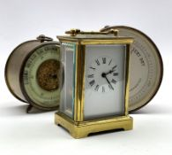 Early 20th century brass and glass carriage timepiece, with white enamel dial and 30 hour movement,