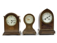 Early 20th century mantel clock with inlaid amboyna panels, eight day striking movement, white ename