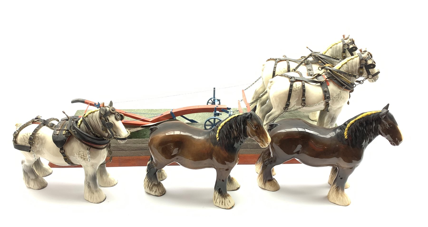 Pair of Beswick grey harnessed shire horses No.818 pulling a single furrow plough and on a wooden ba