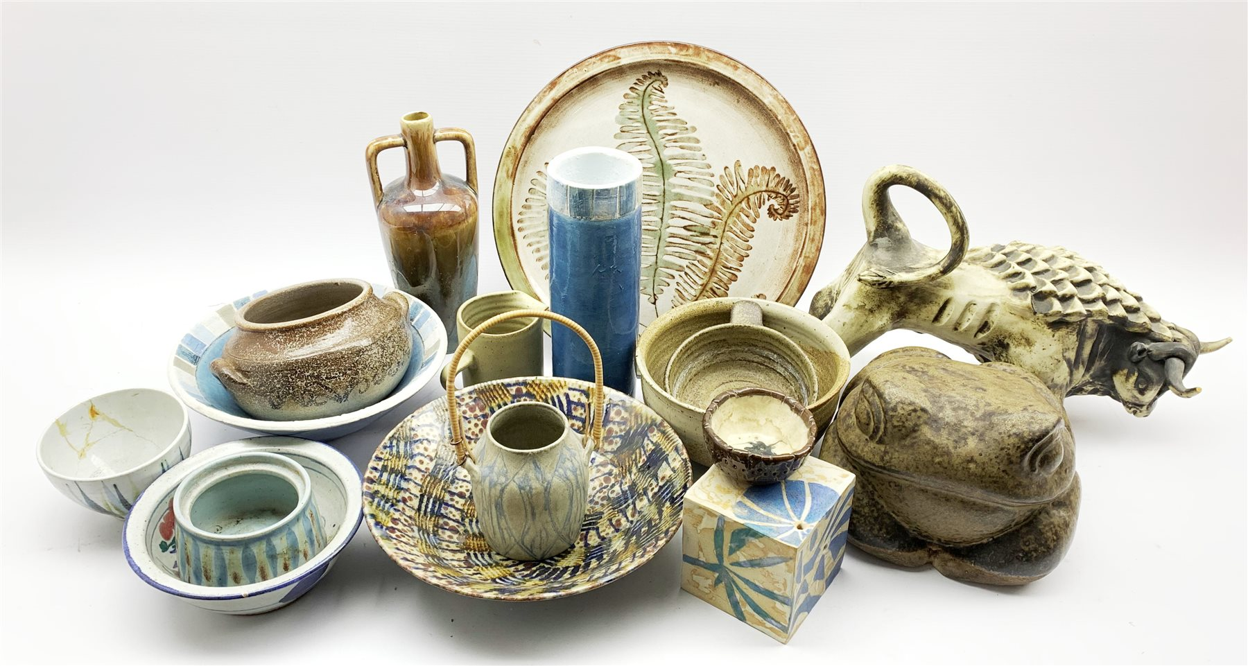 Collection of studio pottery to include a Danish stoneware basket with cane handle, a glazed bowl wi
