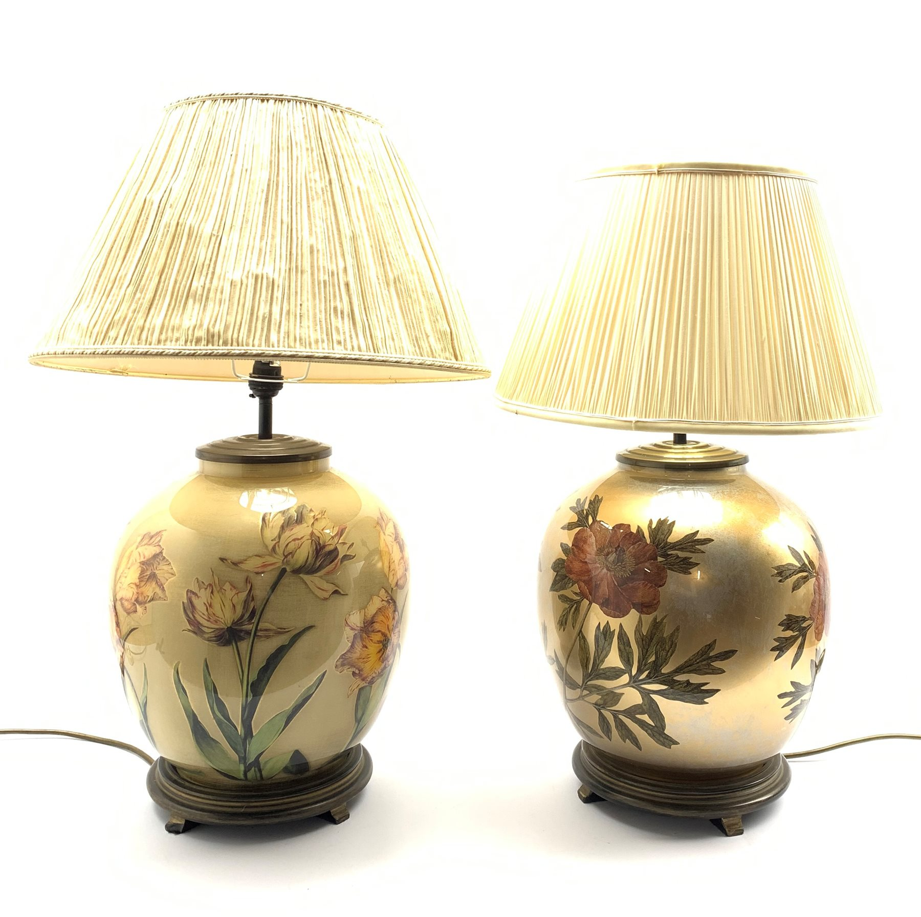 A near pair of glass table lamps having floral decoration on lustre ground, with pleated shades, H66