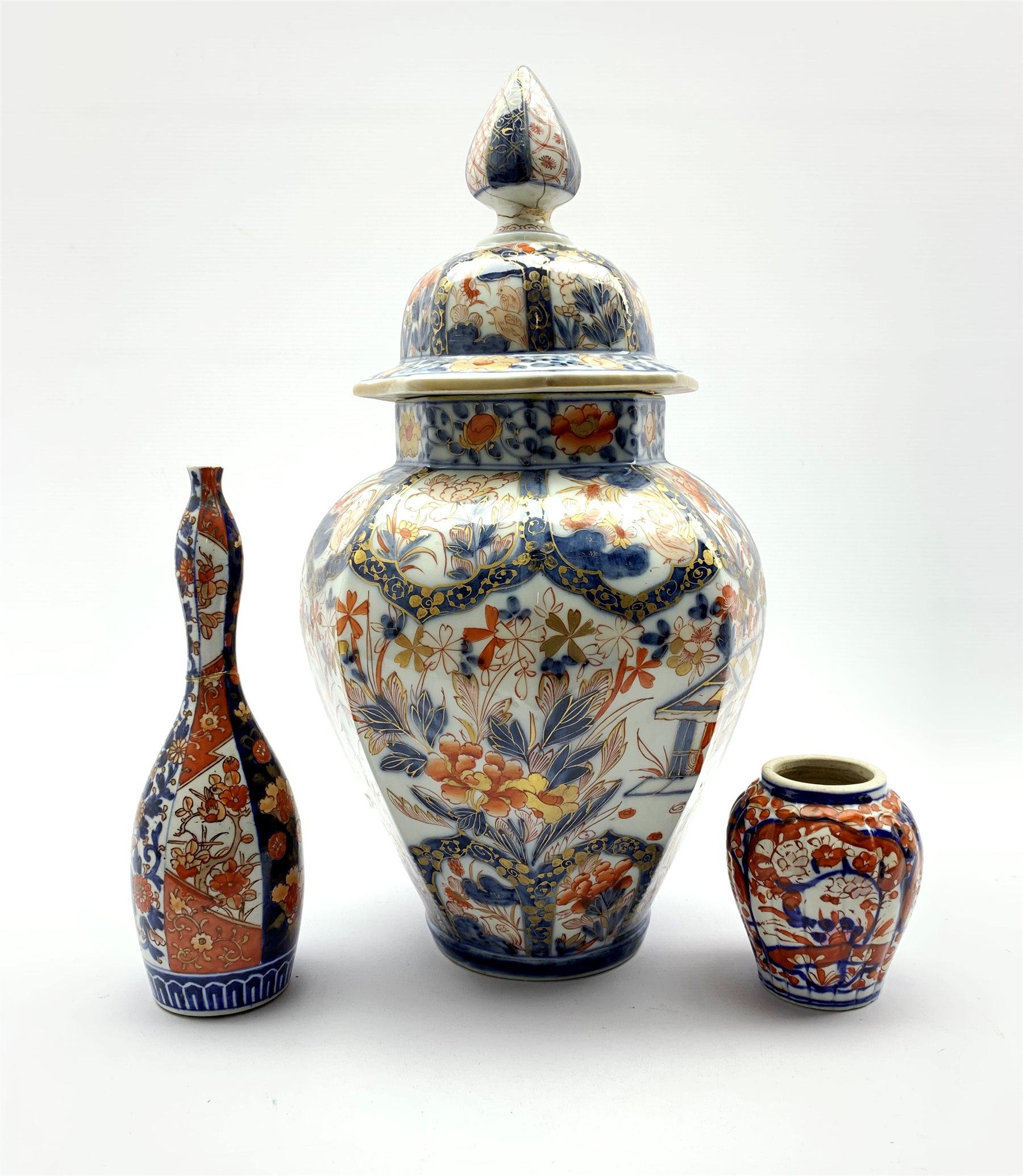 Japanese Imari pattern vase and cover of panel sided design decorated in orange blue and gilt H43cm