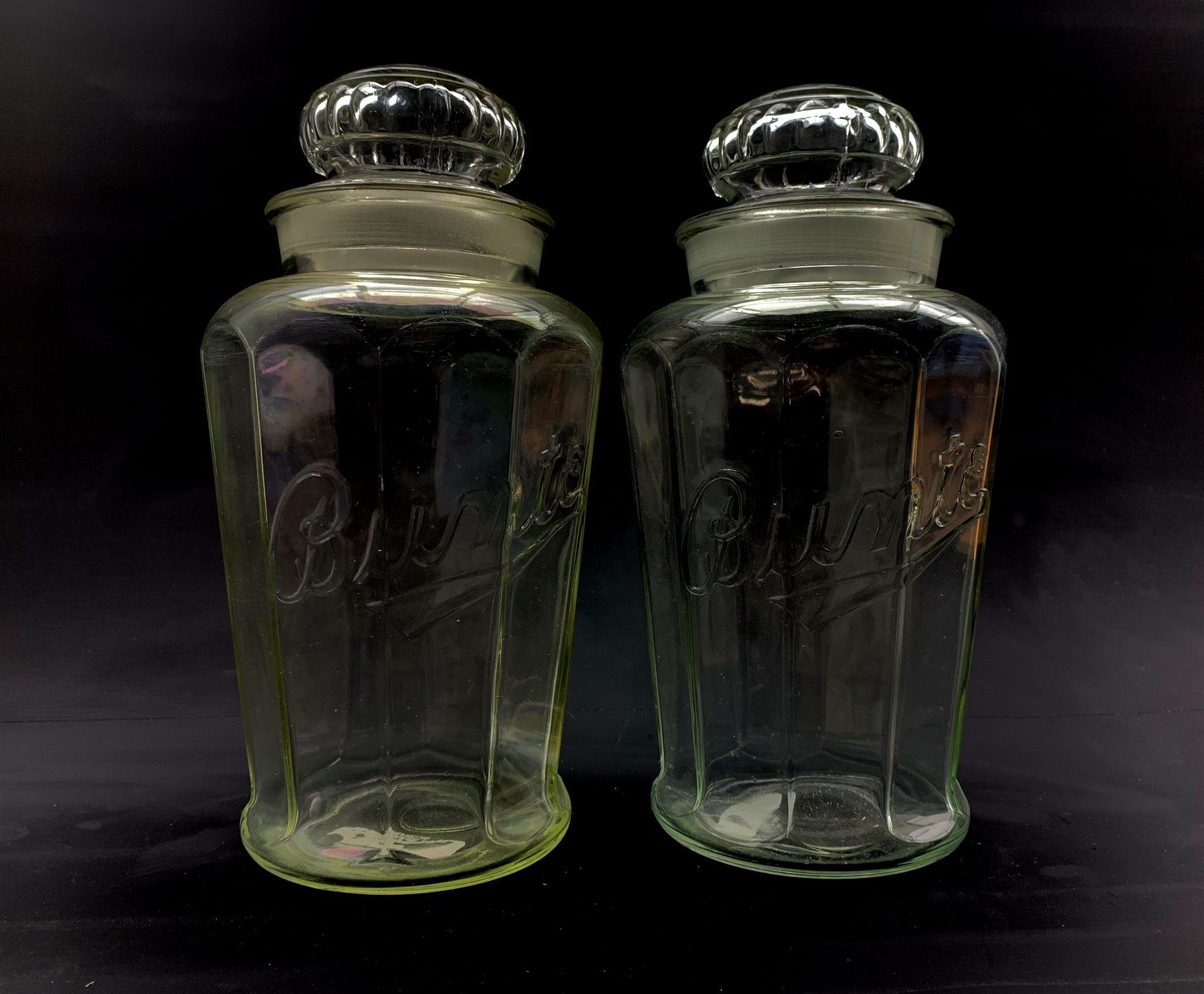 Pair of 1930's American 'Bunte' advertising candy jars and covers, H32cm