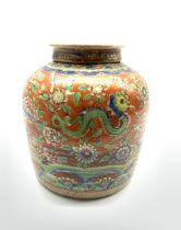 Chinese red ground ginger jar and cover, decorated in underglaze blue with a mountanious landscape a