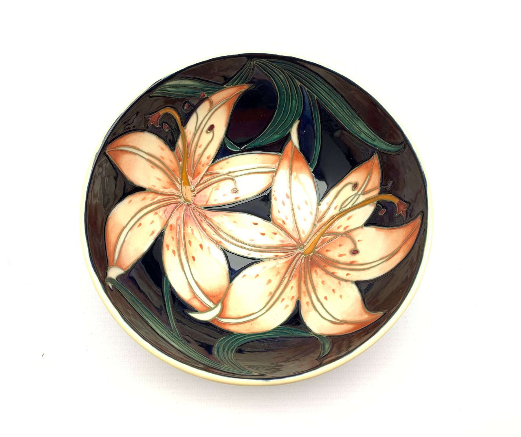 Moorcroft bowl decorated in the Pink Damask pattern by Philip Gibson D16cm, signed, dated 2004 and b