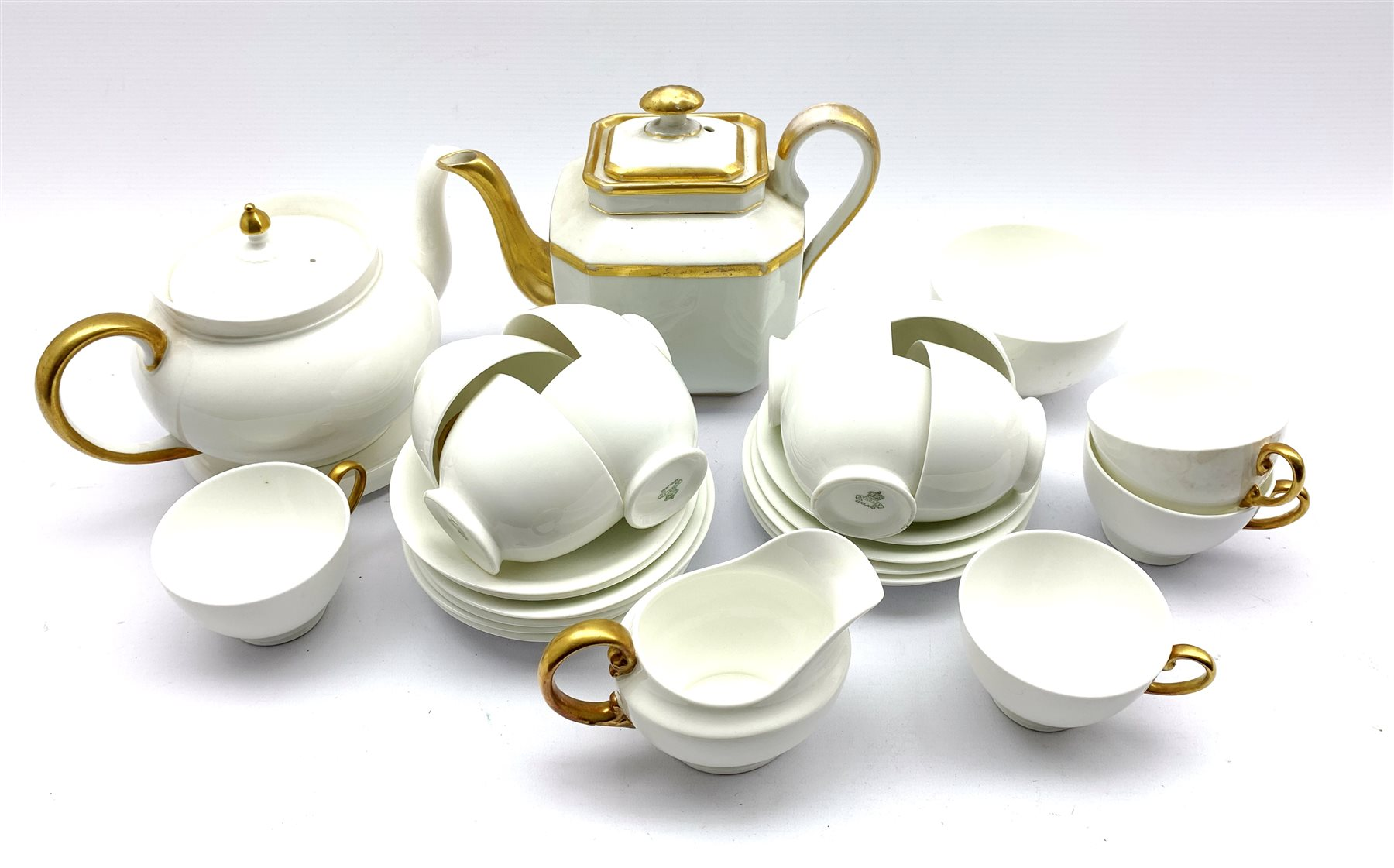 Aynsley part tea set in white with gilt handles comprising twelve cups and saucers, tea pot and stan