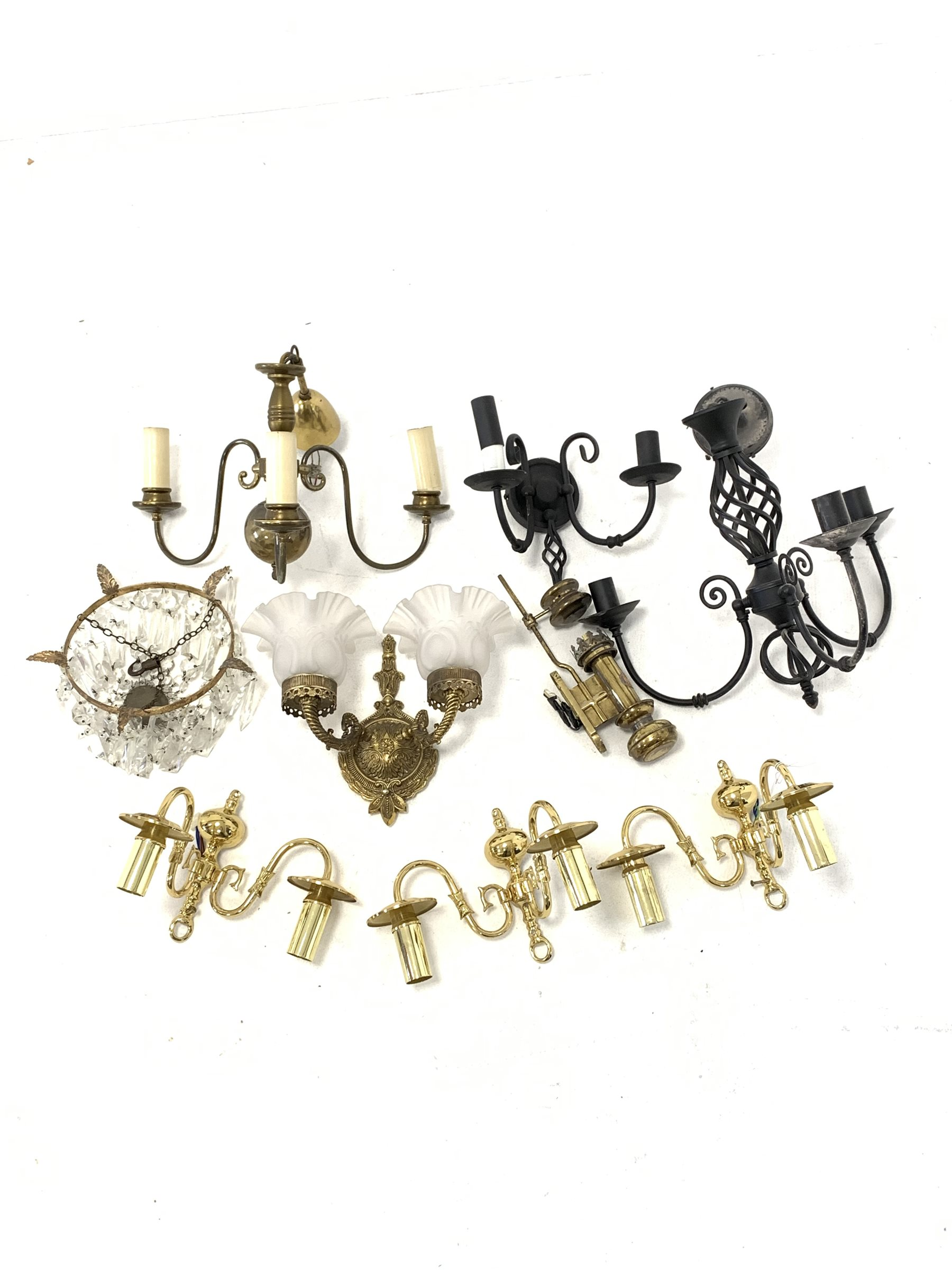 Gilt metal circlet light fitting hung with lustre drops, four various wall lights, reproduction Whit