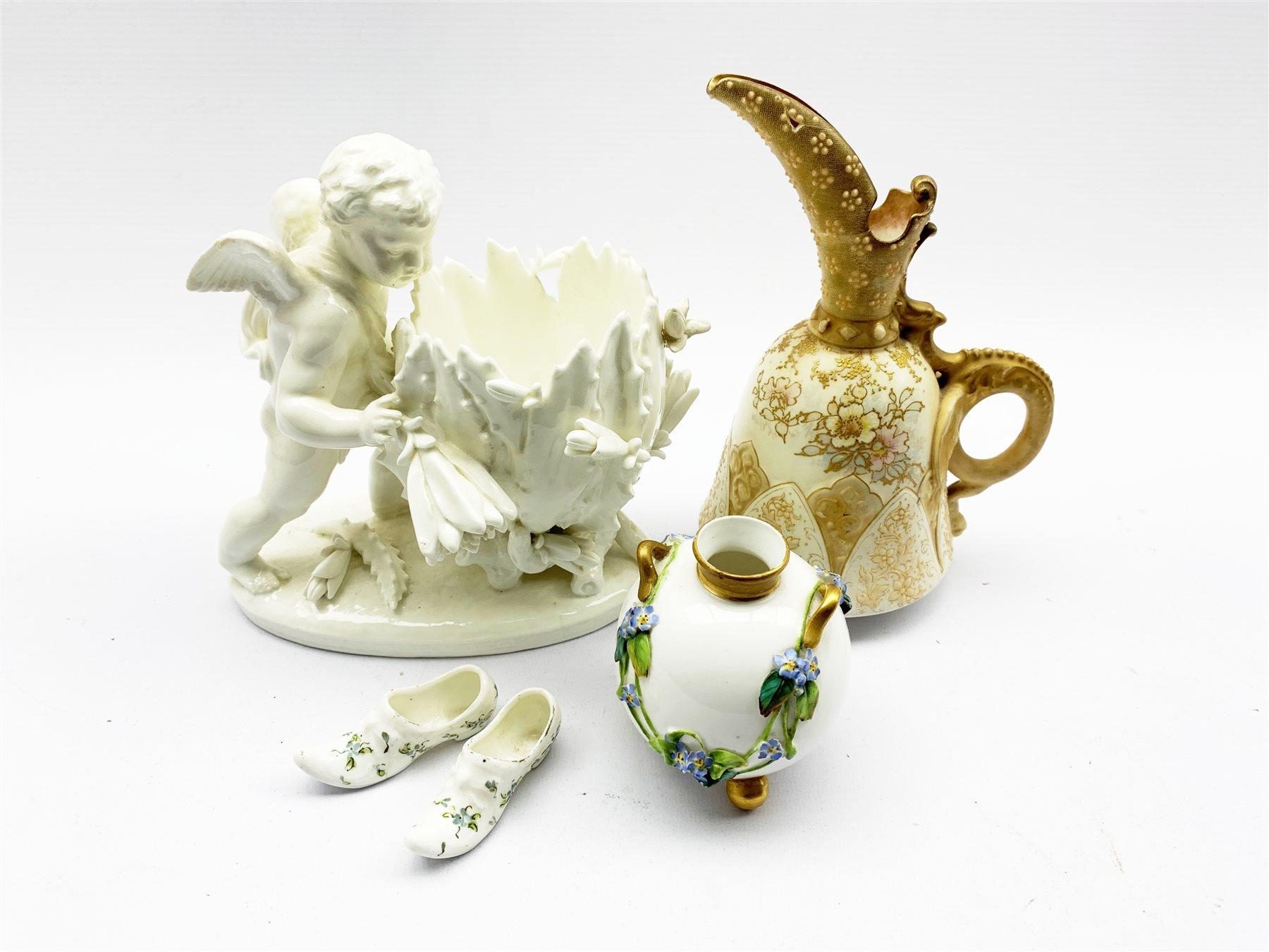 Sitzendorf Blanc de Chine porcelain vase modelled as a Cherub, Royal Worcetser porcelain twin-handle
