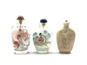Two Chinese inside-painted glass snuff bottles, together with an early 20th century ivory snuff bott