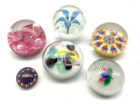 Six glass paperweights including two by Strathearn, Caithness, another having latticinio and leaf de