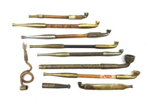 A collection of Japanese Kiseru smoking pipes, to include bamboo and brass long stemmed examples and