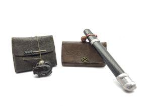 Two Japanese leather tobacco pouches (tabako-ire), one with incised black lacquer pipe case (Kiseruz