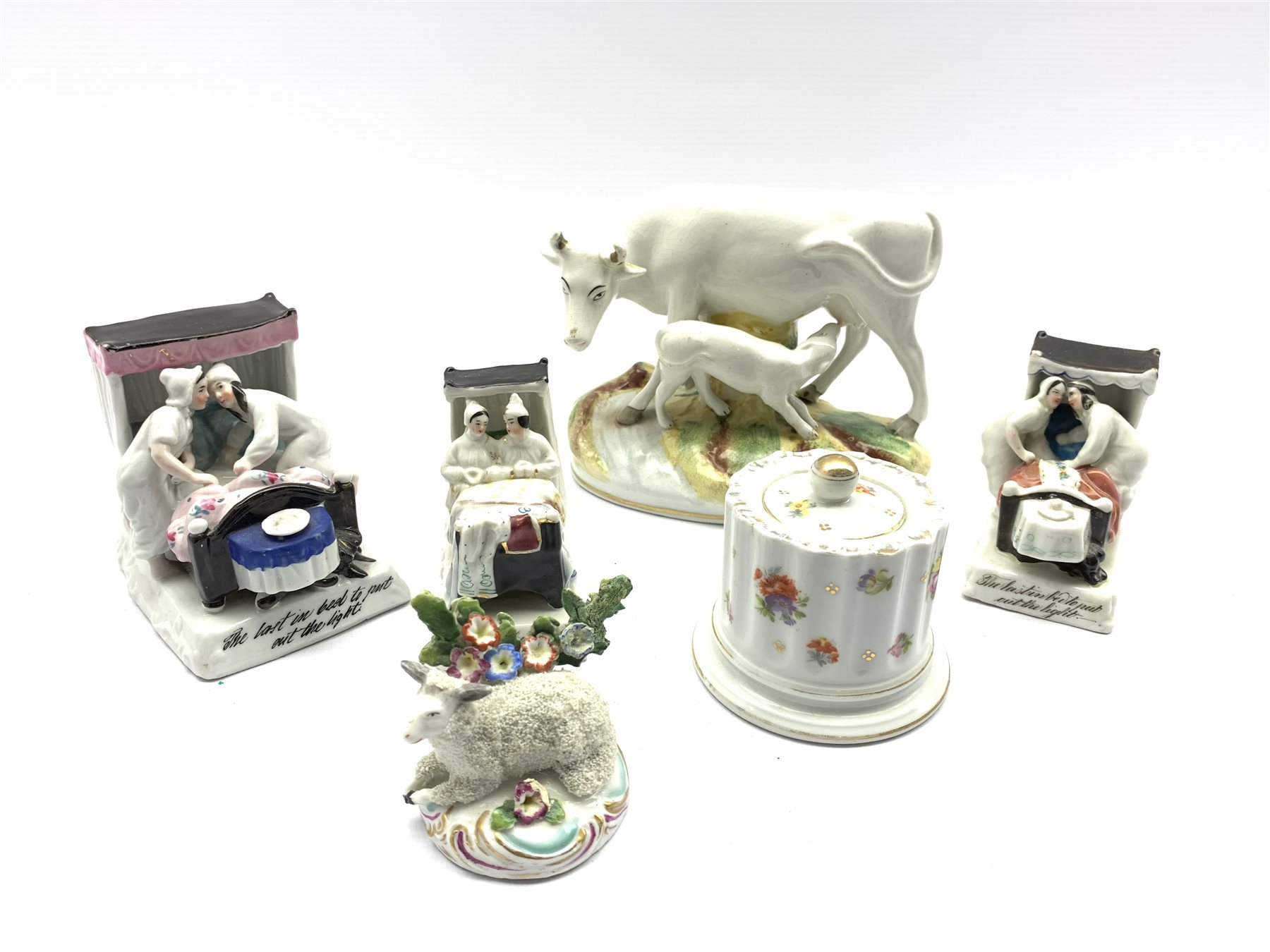 Late 19th/early 20th century Staffordshire pottery cow and calf on naturalistic base W17cm