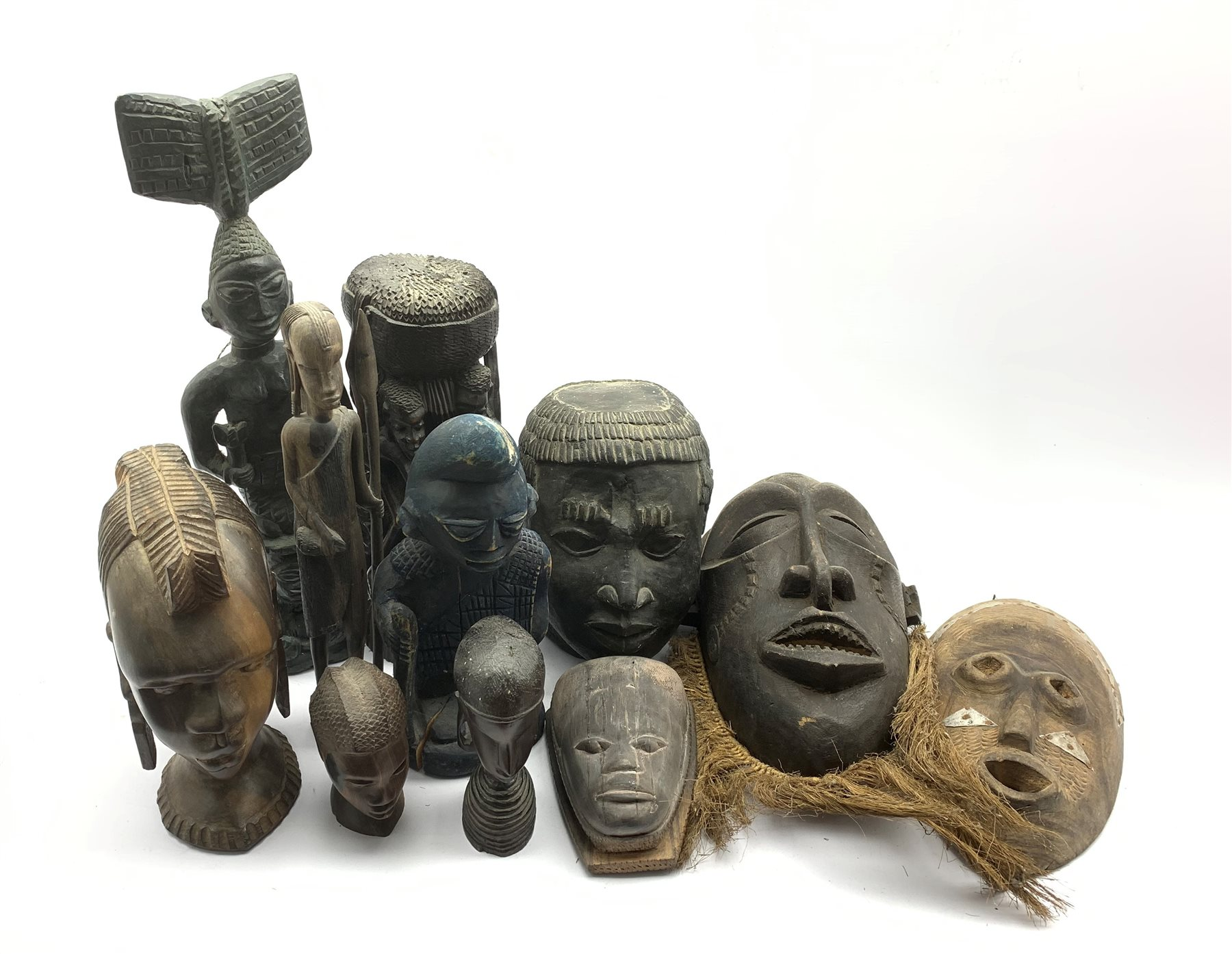 Number of ebony and other carved African heads, African masks, plaster head etc