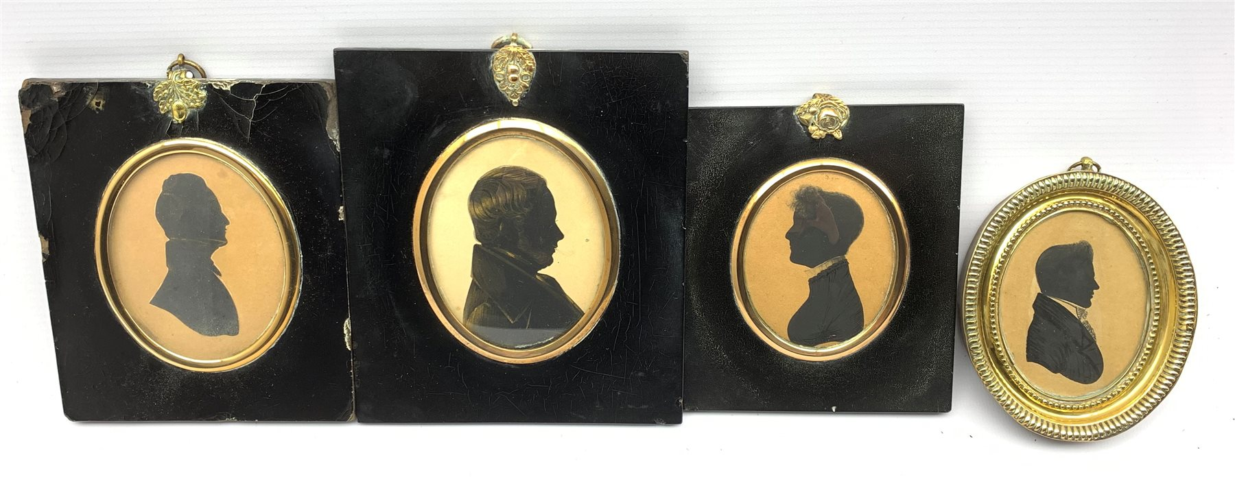 19th Century silhouette profile portrait of a gentleman with gilt highlights and inscribed to the re