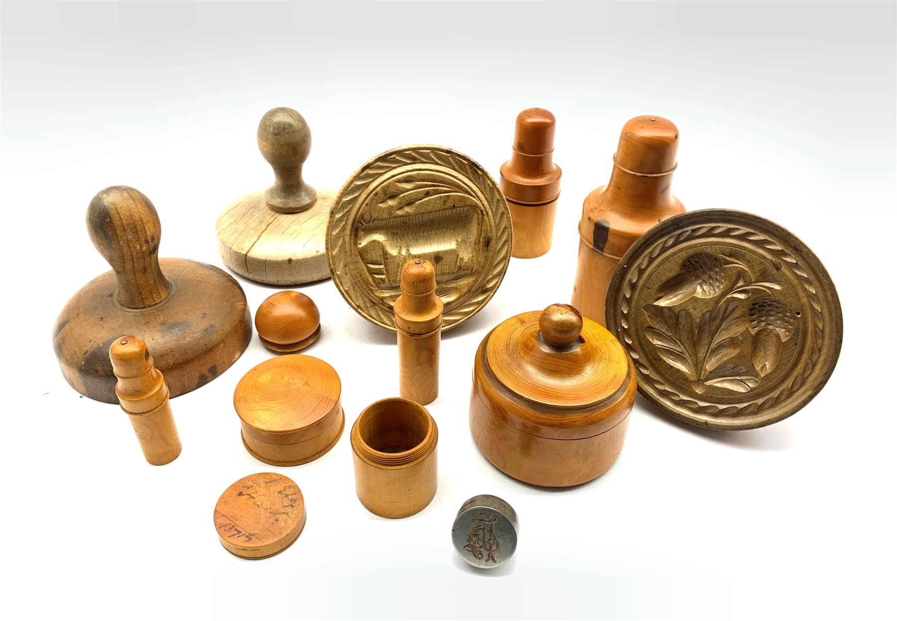 Four various 19th century treen butter stamps