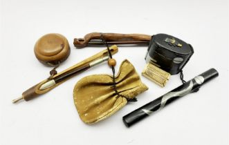 Three Japanese smoking sets comprising a leather pouch (tabako-ire) with naturalistic kiseruzutsu (p