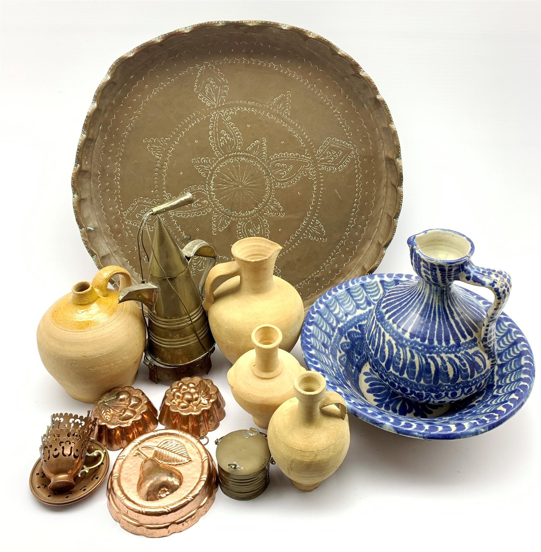 Moroccan earthenware blue and white ewer and basin, four terracotta jars, North African brass coffee