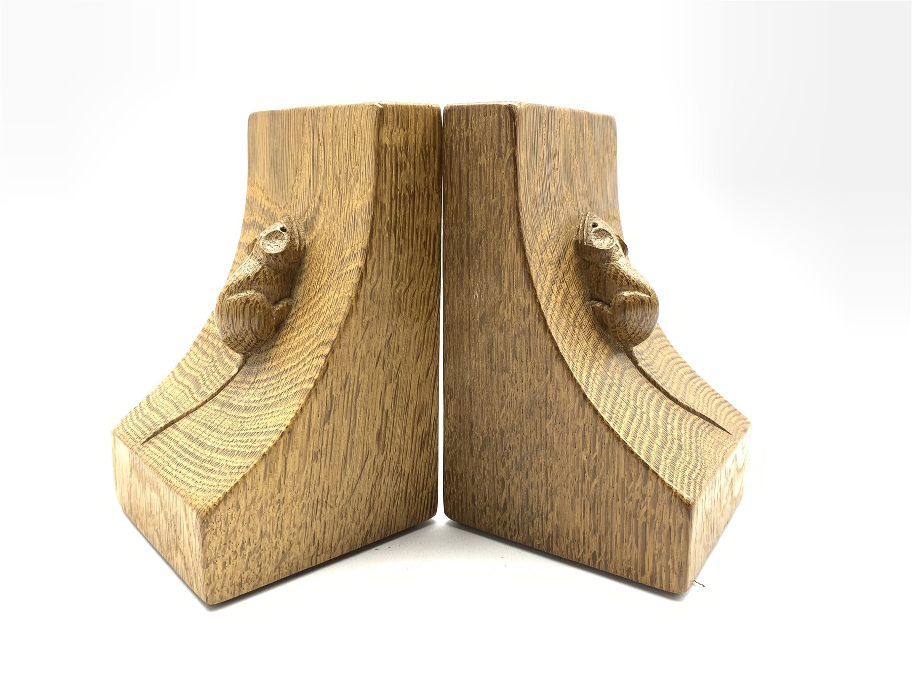 Pair of Thompson of Kilburn 'Mouseman' adzed oak bookends with carved mouse signature to each end H1