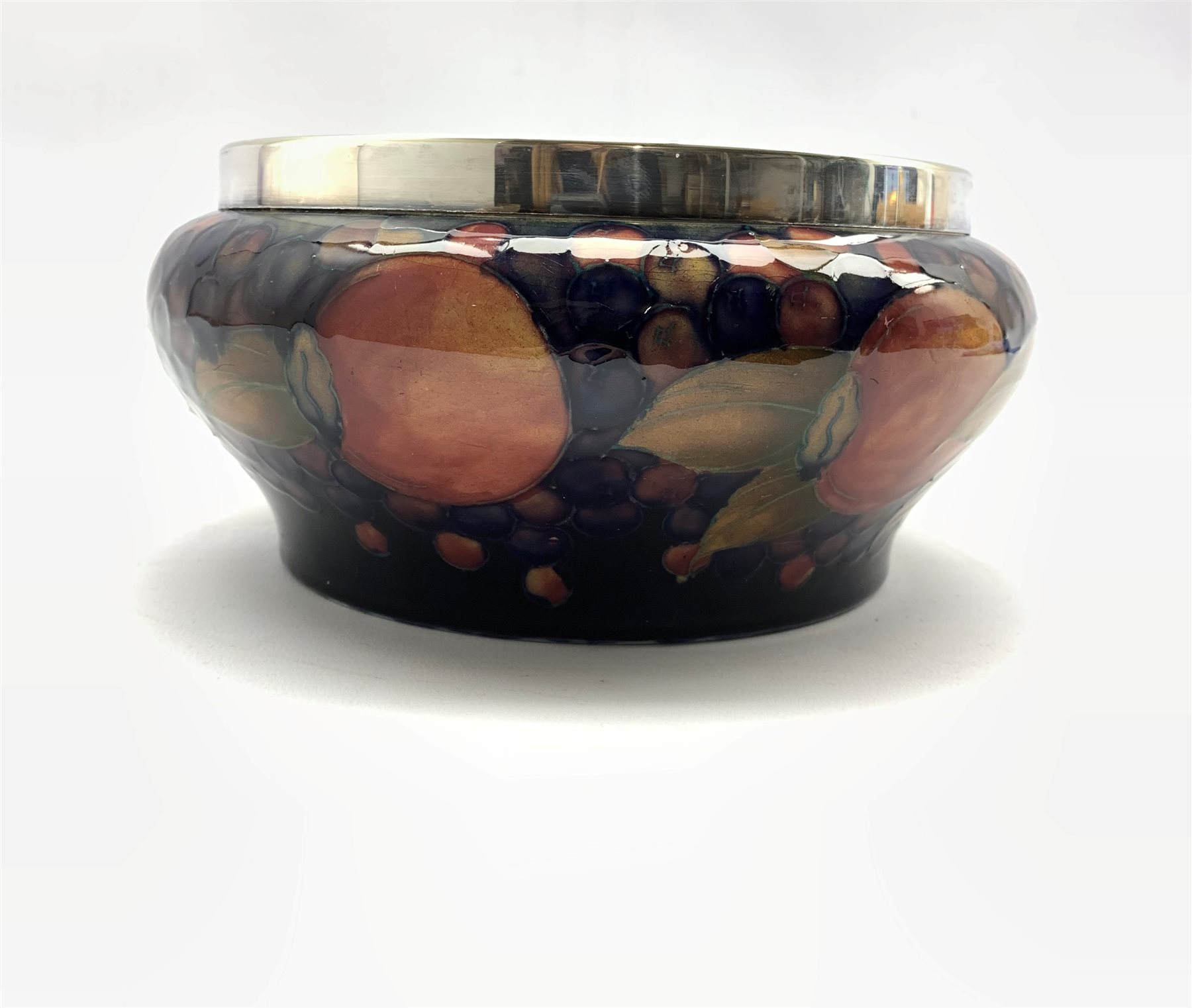 Walter Moorcroft fruit bowl decorated with pomegranates and berries, plated rim and green initial ma - Image 3 of 9