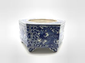 Chinese hexagonal ink stone decorated with Phoenix among scroll work in blue and white and with blue