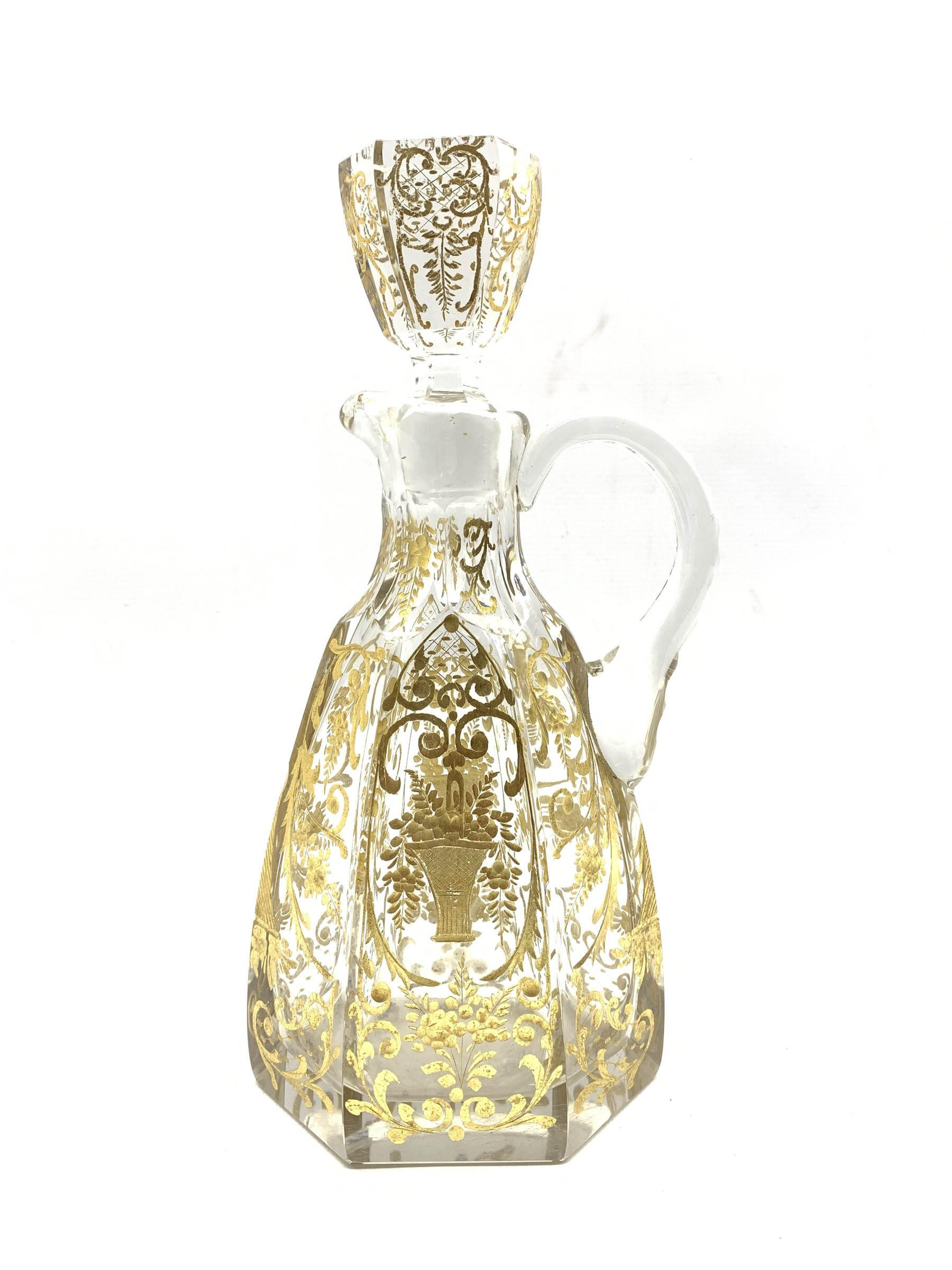 Early 20th century French glass claret jug of hexagonal design incised and gilded with trailing foli