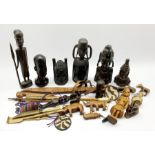 Number of African carved wood tribal figures, African sword in leather scabbard and other African i