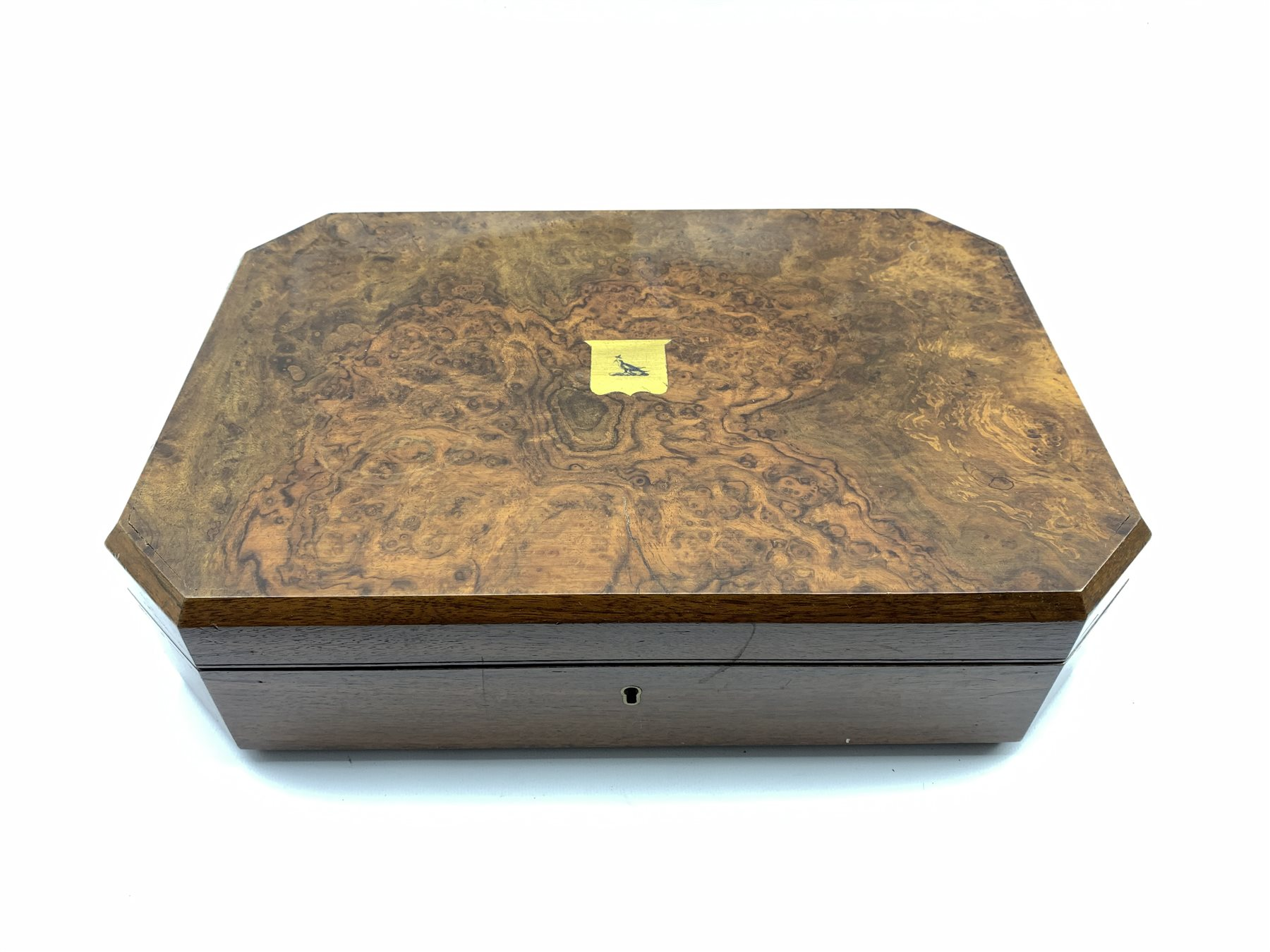 Late Victorian fitted walnut cutlery box with canted corners and burr top inset with central brass s