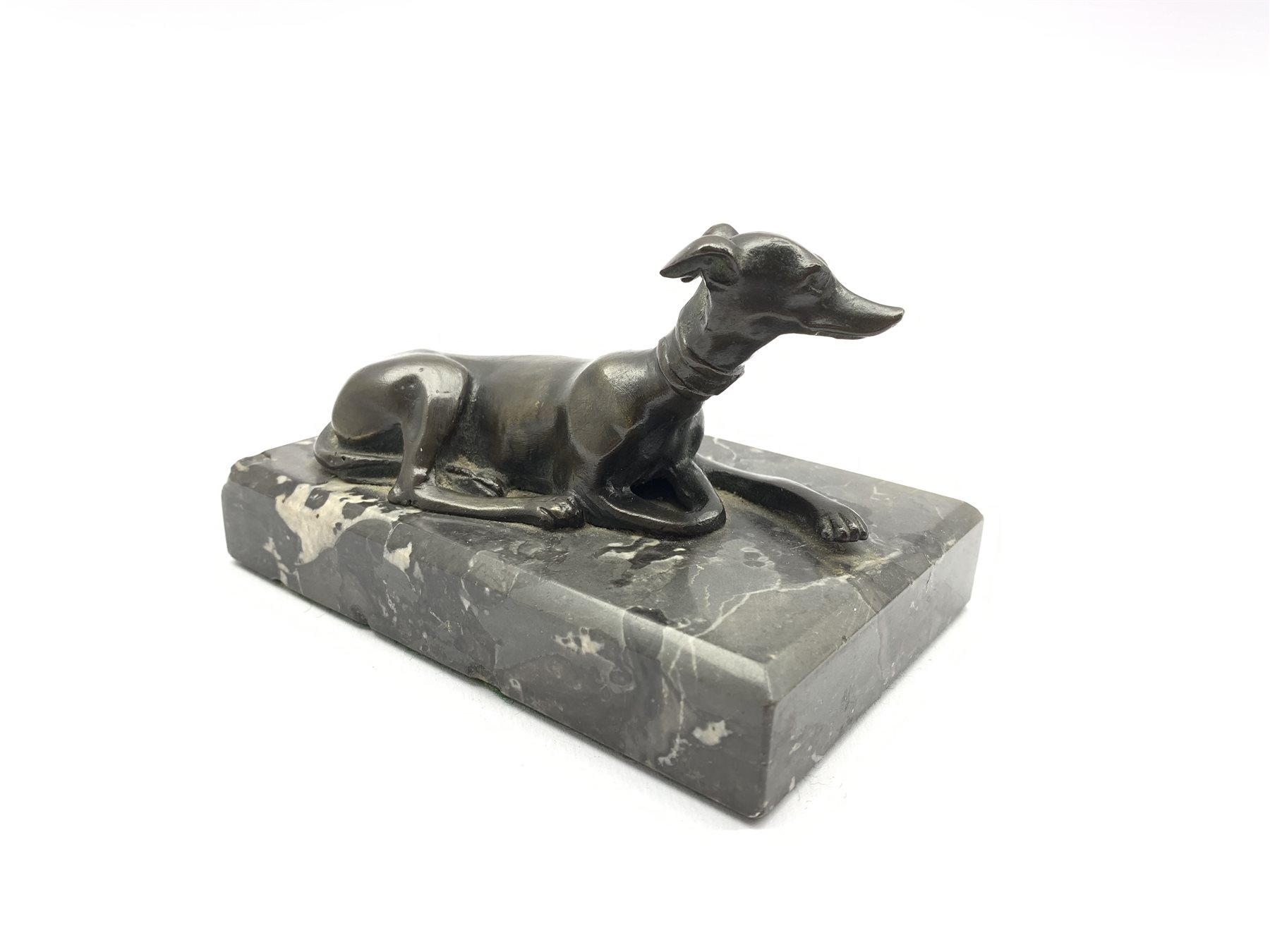 Desk paperweight in the form of a bronze recumbent greyhound on a veined grey marble base W13cm