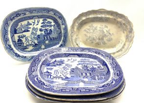 Four 19th century blue and white transfer printed meat plates decorated in the Willow pattern