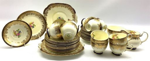 Collingwood Bros. tea set decorated with floral sprays within a blue and gilt border comprising twel