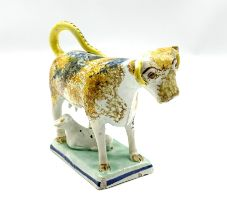 19th century Pratt type cow creamer with calf sponged in manganese and cobalt and on a rectangular p