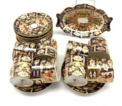 Eight Royal Crown Derby Duesbury coffee cans and saucers Patt.2451 and a matching oval dish