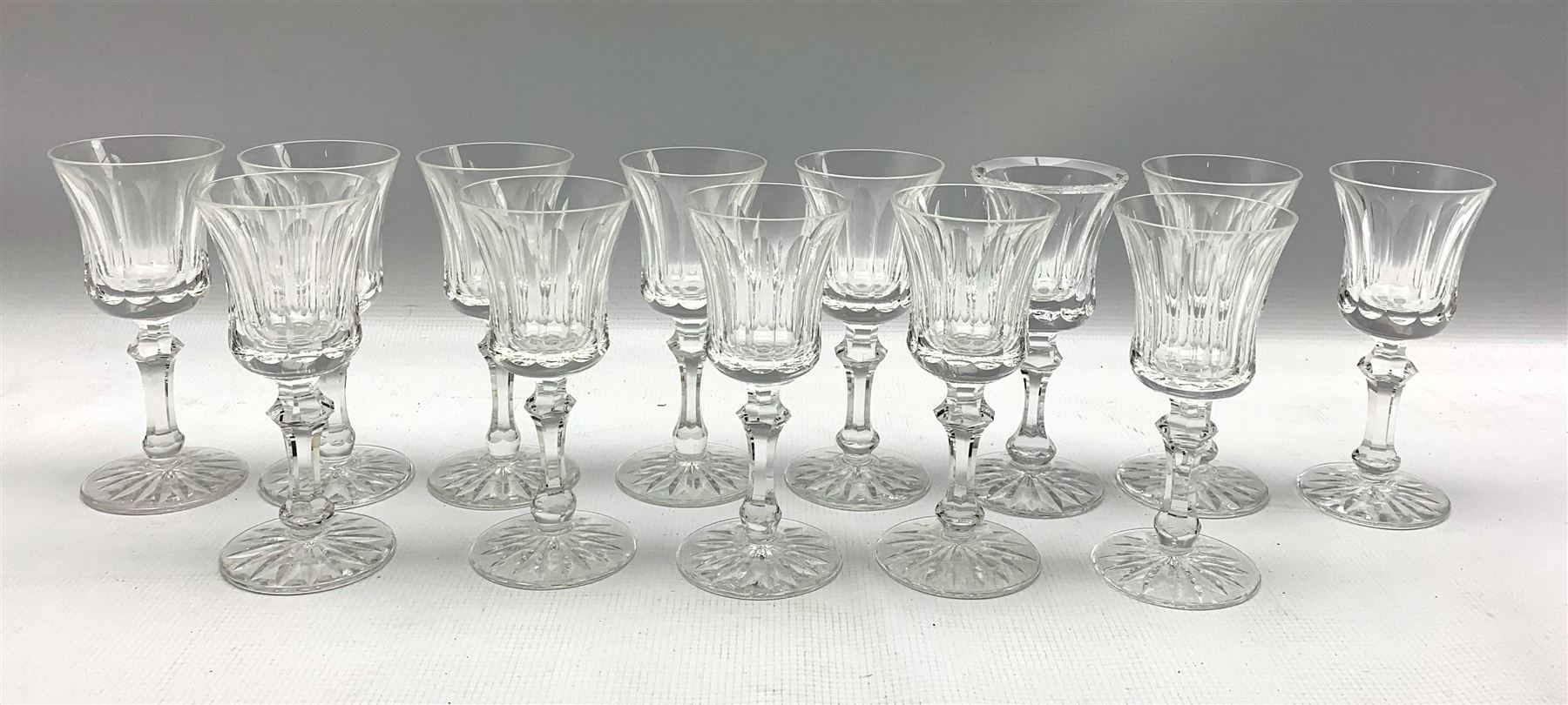 Set of thirteen Waterford Innisfail pattern small wine or sherry glasses H15cm