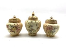 Pair of Royal Worcester pot pourris and covers decorated with floral sprays on a blush ivory ground