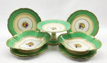 Aynsley dessert service painted with a centre panel of fruit within a green and gilt border comprisi