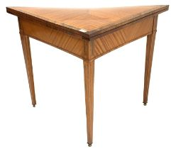 Crossbanded satinwood card table of triangular form with baize lined interior on square tapering sup