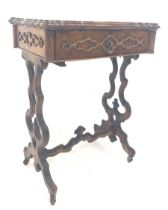 Victorian walnut sewing table the serpentine moulded top lifting to reveal fitted interior